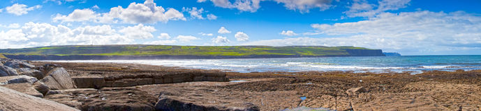 Doolin's Bay, The Burren. Panorama. Doolin's Bay, The Burren, County Clare, Ireland. Cliff's of Moher in the distance Stock Photo