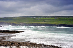 Doolin Shorelane. Rocks and waves on coastline near Doolin, Co.Clare, Ireland during summer storm stock photo