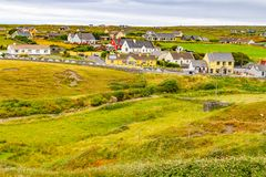 Doolin village with houses and farm fields. Clare, Ireland royalty free stock photo