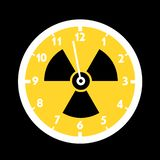 Doomsday clock with symbol of nuclear and atomic radiactivity. Countdown of time as metaphor - Radioactive fallout, disaster and catastrophe is coming. Vector royalty free illustration