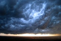 Doomsday clouds. Dark storm clouds over a lighted horizon as in doomsday