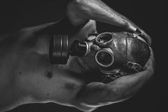Doomsday. A man in a gas mask in the smoke. artistic background Stock Image