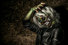 Doomsday. Terrible bloodthirsty zombie woman in the slums. Body-painting project. Glamorous zombie girl. Halloween make-up. Horror Royalty Free Stock Photo
