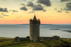 Doonagore castle. In Ireland at sunset Stock Photo
