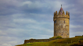 Doonagore Castle. Panoramic view of Doonagore Castle on a overcast day in summer, county Clare, Ireland Stock Photo