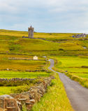 Doonagore Castle. View of Doonagore Castle on a overcast day in summer, county Clare, Ireland Royalty Free Stock Photos