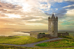Doonagore Castle in the beautiful scenery, Ireland. Doonagore Castle in the beautiful scenery at sunset Ireland Royalty Free Stock Image