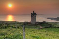 Doonegore castle at sunset in Doolin Royalty Free Stock Photo