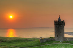 Doonegore castle at sunset in Ireland Royalty Free Stock Image
