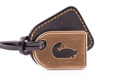 Dooney und Bourke Entwerfer-Marken-Medaillon lizenzfreies stockbild