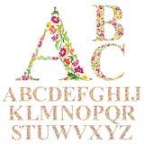 Doopvont met bladeren, bloemen geplaatste die alfabetbrieven wordt gemaakt Stock Foto