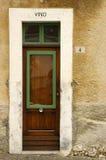 Door 03. Old shop door with the word vino (wine Stock Photo