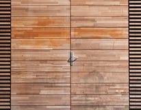 Door. A wooden door with metal door handle Royalty Free Stock Images
