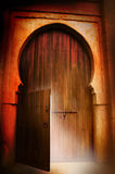 Door. A door opens from a castle and spills light on the ground Royalty Free Stock Photo