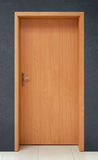 Door. On gray wall background Royalty Free Stock Photography