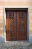 Door. Ancient wood door in Saluzzo, a beautiful town in Italy Royalty Free Stock Photos