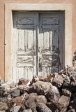Door. With lava rocks in front of it, Santorini,  South Aegean, Greece stock photo