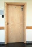 Door 323. Wooden door in modern building Stock Photo