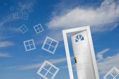 Door (4 of 5). Door and flying windows on sky background. A house of your dream Royalty Free Stock Image