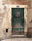 The door. Old wooden door in Lisbon royalty free stock photo