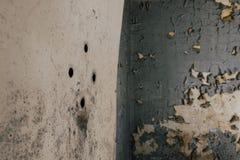 Door - Abandoned Hospital / Sanitarium - New York. An interior view of a door with peepholes inside an abandoned hospital in New York stock image