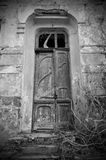 The door of an abandoned house stock photo