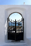 Door above aegean sea in Santorini Stock Image