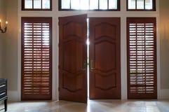 Door ajar with light shining in Stock Image