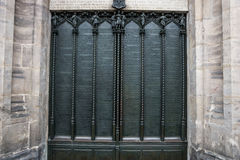 Door of the All Saints church in Wittenberg Germany with the ninety-five theses Royalty Free Stock Photo