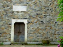 A door on an ancient wall Stock Photography