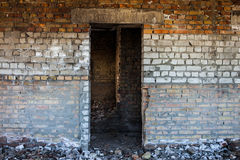 Door aperture inside the old ruined brick building Royalty Free Stock Photos
