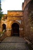 Door of arabic palace and stone wall. View of stone wall and door in arabic palace in Spain Stock Images