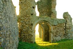 Door arch of ruin. Door arch of old church ruin with  the sun shining through the archway Royalty Free Stock Photo
