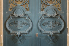 Door architectural exteriors details of the Louvre museum Royalty Free Stock Photography