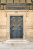 Door architectural exteriors details of the Louvre museum Royalty Free Stock Images