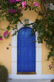 Door at Assos. Blue door surrounded by bougainvillea at Assos on the Greek island of Kefalonia Stock Photos