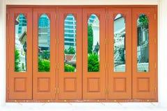 Door background. Old ancient door in Thai temple stock photo