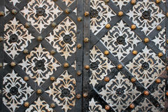 Door background. Part of an old decorated door with rhombus Royalty Free Stock Image