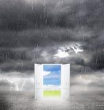 Door from bad weather. To good stock image