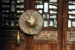 Door and bamboo hat. Wood door and bamboo hat stock photography
