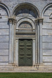 Door of the baptistery at the piazza dei miracoli in Pisa Stock Images
