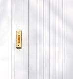 Door Bell. In a white, wooden wall Stock Photography