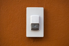 Door bell on brown wall background Royalty Free Stock Photo