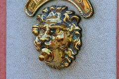 Door bell in the shape of a golden lion Royalty Free Stock Image