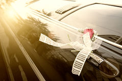 Door of black wedding car with flower Stock Images