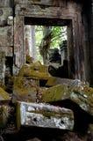 Door blocked. Mossy rocks in front of door of preah khan Stock Photography
