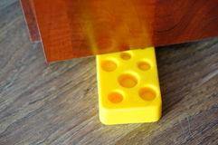 Door blocker. In cheese shape royalty free stock images