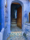Door into the blue house of Allah royalty free stock image