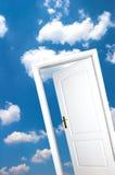 Door on blue sky Royalty Free Stock Image