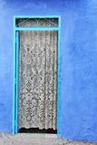 Door and blue wall Royalty Free Stock Photography